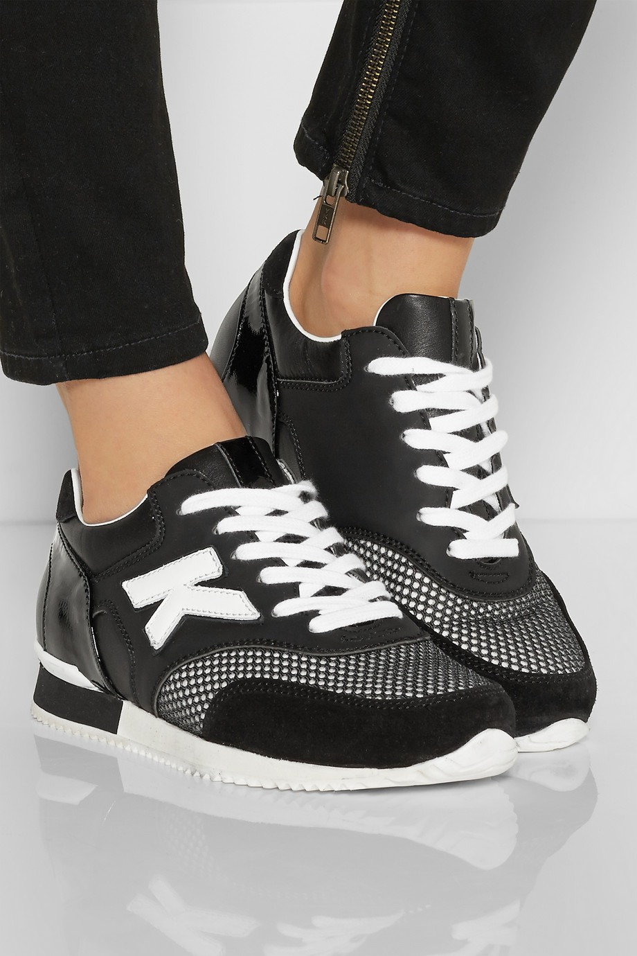 Karl Lagerfeld begins to produce custom-made sneakers
