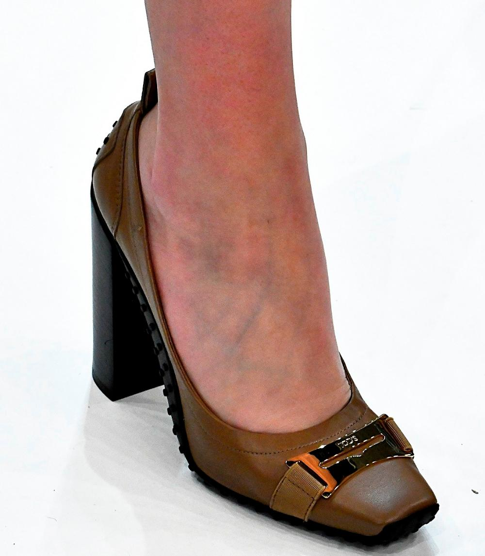 Leather material. Heel: steady. Decor: rivets + buckle