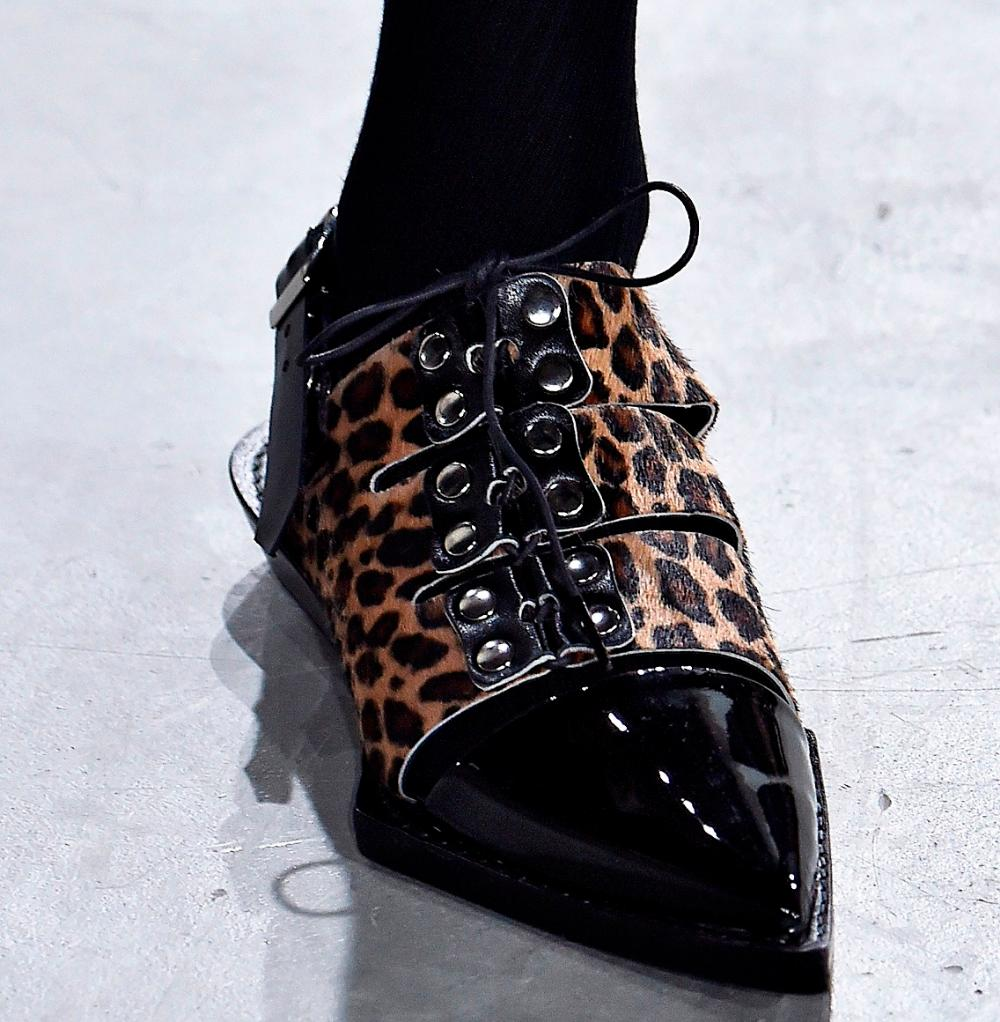 Material: patent leather. Decor: ties. Print: leopard. Construction: Open Heel